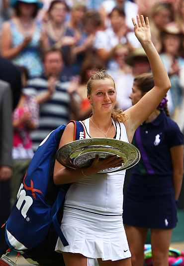 Petra Kvitova celebrates after winning her Ladies' final against Maria Sharapova on Day Twelve of the Wimbledon Lawn Tennis Championships