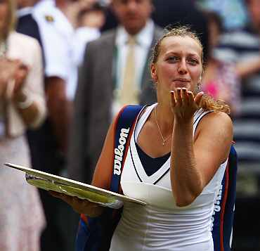 Petra Kvitova blows a kiss after winning her Ladies' final against Maria Sharapova