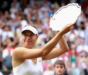 Maria Sharapova hold up her second place thropy after losing her Ladies' final round match against Petra Kvitova