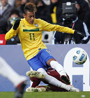 Brazil's Neymar clears the ball as Venezuela's Gabriel Cichero challenges during their Copa America soccer match in La Plata on Sunday