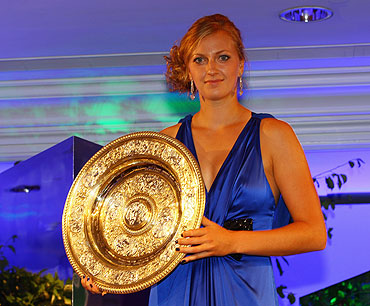 Petra Kvitova holds the womens trophy at the Wimbledon Championships 2011 Winners Ball on Sunday