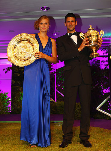 Novak Djokovic of Serbia and Petra Kvitova of Czech Republic hold their winners trophies at the Wimbledon Championships 2011 Winners Ball on Sunday