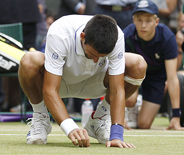 Novak Djokovic plucks the grass from the turf to eat it after beating Rafael Nadal in the men's single final at the Wimbledon on Sunday
