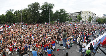 Supporters gather to celebrate Novak Djokovic's arrival in Belgrade on Monday