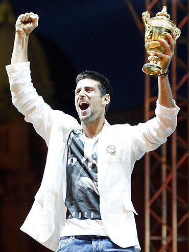 Novak Djokovic greets supporters upon arrival in Belgrade on Monday