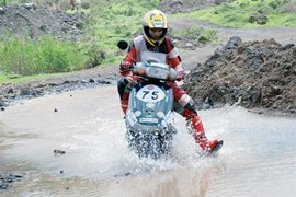 A rider negotiates water-logged terrain during last year's rally