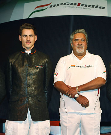 Force India's Adrian Sutil with Vijay Mallya
