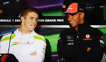 Paul di Resta of Force India and Lewis Hamilton of McLaren