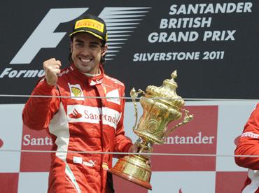 Ferrari Formula One driver Fernando Alonso of Spain celebrates winning the British F1 Grand Prix at Silverstone