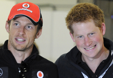 McLaren Formula One driver Jenson Button of Britain speaks with Britain's Prince Harry (R) before the British F1 Grand Prix at Silverstone