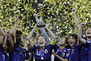 Japan players celebrate after winnng the women's World Cup