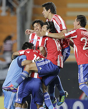 Paraguay players celebrate after beating Brazil in a penalty shootout in their quarter-final soccer match at the Copa America in La Plata on Sunday