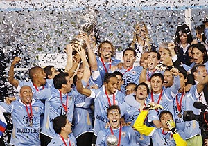 Uruguay players and officials celebrate winning the Copa America final against Paraguay in Buenos Aires on Sunday