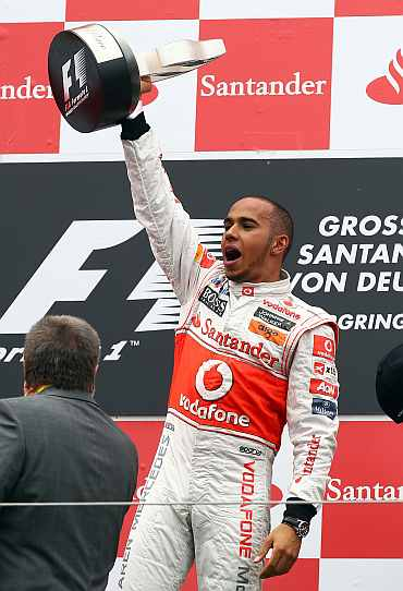 Lewis Hamilton celebrates after winning the German Grand Prix