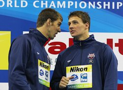 Gold medalist Ryan Lochte (R) talks with silver medalist Michael Phelps after the men's 200m Individual Medley final