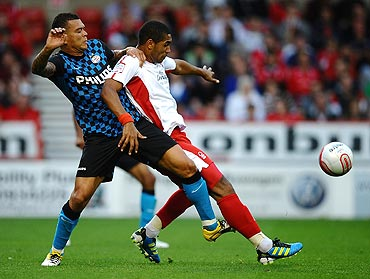 Lewis McGugan Nottingham Forest (right) battles for the ball with Wilfred Bouma of PSV during their pre-season friendly at City Ground on Wednesday