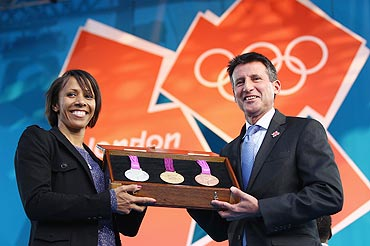 Kelly Holmes and LOCOG Chairman Sebastian Coe present the olympic medals during the' London 2012 - One Year To Go' ceremony in Trafalgar Square on Wednesday