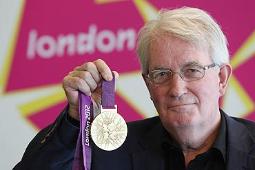 Designer David Watkins poses with the 2012 Olympic games gold medal