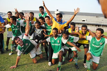 Salgaocar players celebrate after beating JCT and making sure of the I-League crown