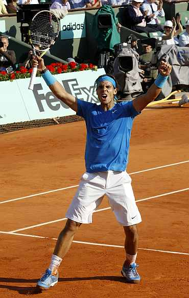 Rafa Nadal celebrates after winning his match against Robin Sodeling in Paris
