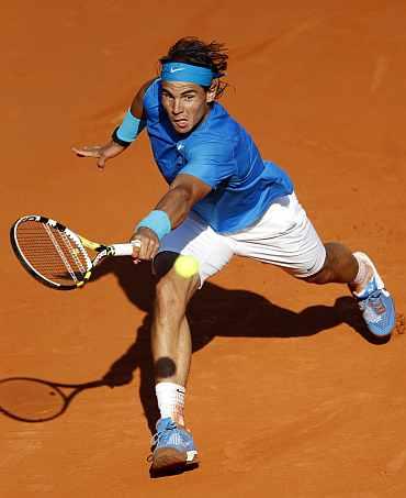 Rafa Nadal returns during his quarter-final match against Robin Soderling in Paris