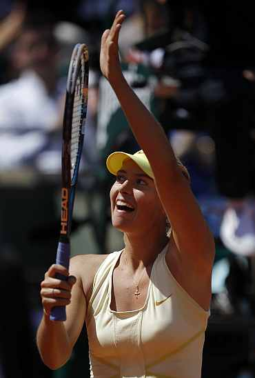Maria Sharapova reacts after winning her match against Andrea Petkovic in Paris