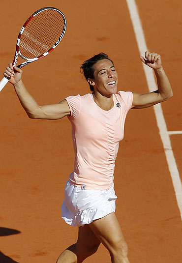 Francesca Schiavone reacts after defeating Marion Bartoli