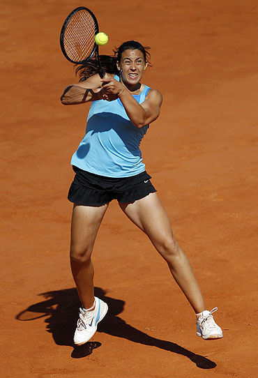Marion Bartoli returns the ball