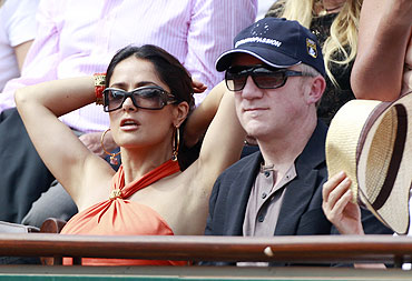 French businessman Francois-Henri Pinault and his actress wife Salma Hayek watch the semi-final match between Rafael Nadal and Andy Murray