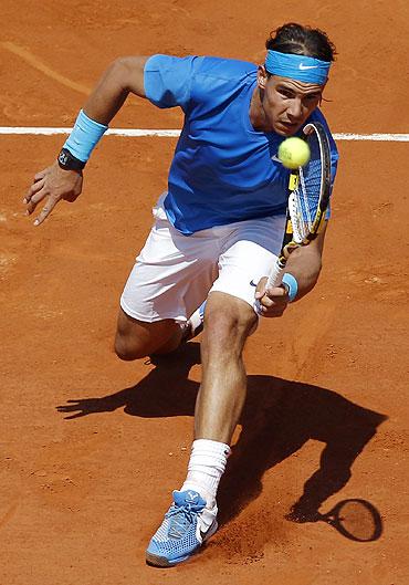 Rafael Nadal plays a return