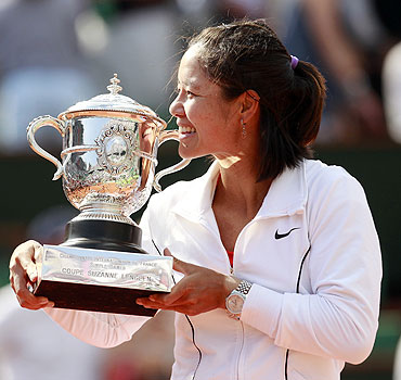 Li Na of China poses with the trophy after winning her women's final against Francesca Schiavone of Italy at the French Open on Saturday