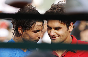 Rafael Nadal and Roger Federer shake hands after the French Open final