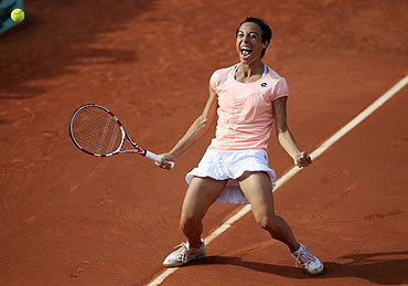 Francesca Schiavone of Italy reacts after winning her match against Jelena Jankovic of Serbia