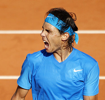 Rafael Nadal reacts during his quarter-final match against Robin Soderling