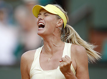 Maria Sharapova reacts during her match against Agnieszka Radwanska