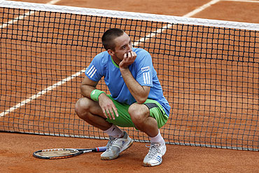 Viktor Troicki reacts during his match against Andy Murray