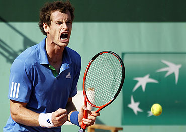 Andy Murray reacts in the match against Triocki