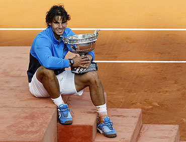 Rafael Nadal poses with the trophy