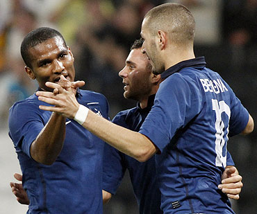 France's Marvin Martin (centre), Florent Malouda (left) and Karim Benzema celebrate after beating Ukarine in an international friendly on Monday