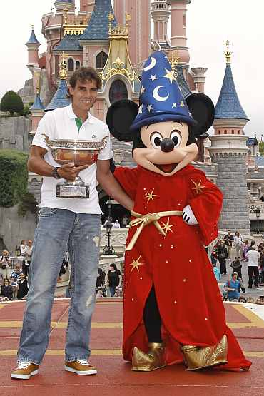 Rafael Nadal poses for photos at the Disneyland Resort in Marne-la-Vallee outside Paris