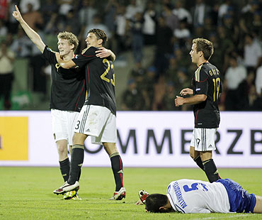 Germany's Mario Gomez (2nd from left) and Andre Schurrle (left) celebrate their victory over  Azerbaijan