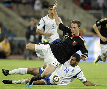 Germany's Benedikt Howedes (foreground) is challenged by Azerbaijan's Rashad F Sadygov