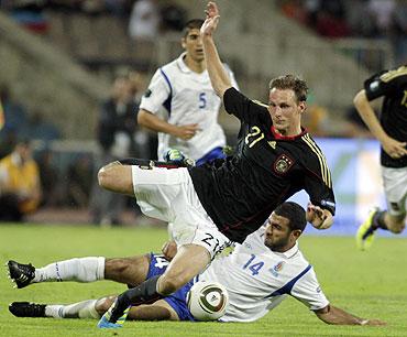 Germany's Benedikt Howedes (foreground) is challenged by Azerbaijan's Rashad F Sadygov