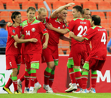 Belarus' Sergei Kornilenko (centre) celebrates with teammates after scoring against Luxemburg