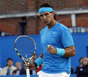 Rafa Nadal reacts after winning his match against Matthew Ebden at the Queen's Club championships