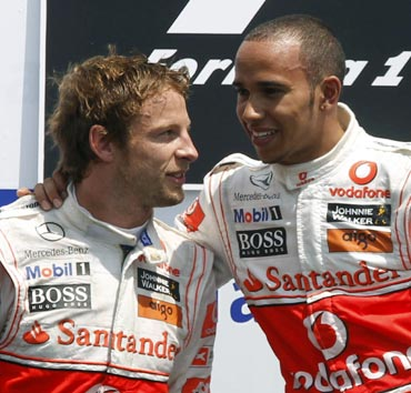 Lewis Hamilton (left) with team-mate Jenson Button