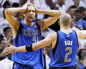 Dallas Mavericks' Dirk Nowitzki (L) celebrates with teammate Jason Kidd near the end of Game 6 of the NBA Finals basketball series against the Miami Heat in Miami