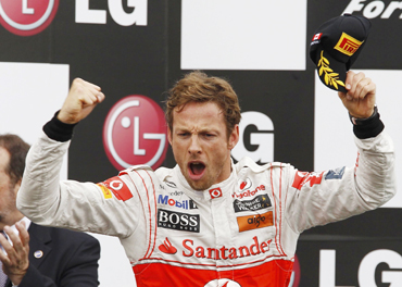 McLaren Formula One driver Jenson Button of Britain celebrates winning the Canadian F1 Grand Prix on the podium at the Circuit Gilles Villeneuve in Montreal