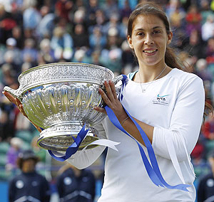France's Marion Bartoli celebrates with the trophy after beating Czech Republic's Petra Kvitova