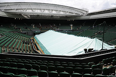 The covers pulled across Centre Court during rainy weather on Sunday